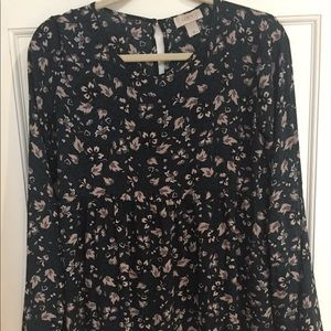 Tunic style flowered blouse.
